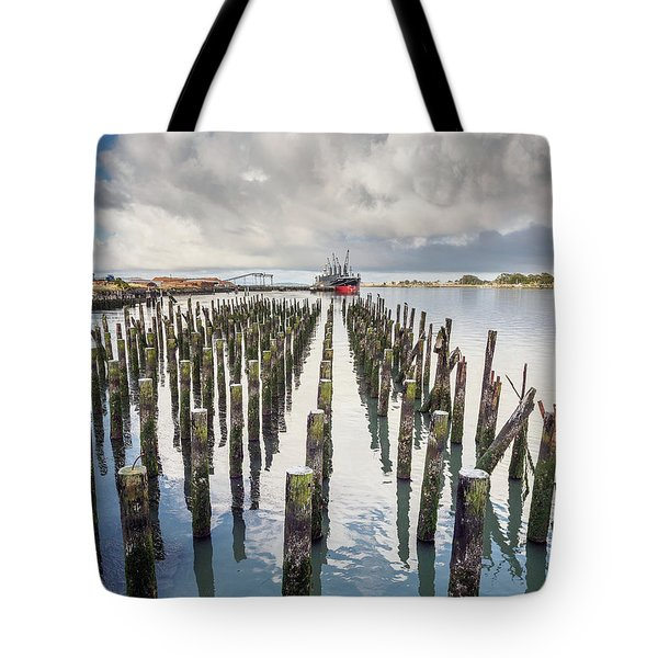 Tote Bag featuring the photograph Pylons To The Ship by Greg Nyquist