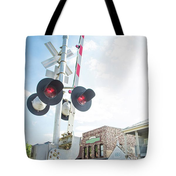 Tote Bag featuring the photograph Railroad Lights In Old Town Helena by Parker Cunningham