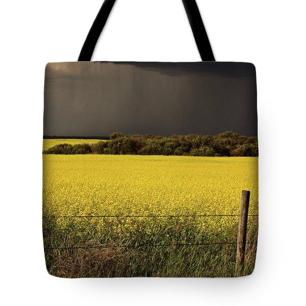 Rain Front Approaching Saskatchewan Canola Crop Tote Bag by Mark Duffy