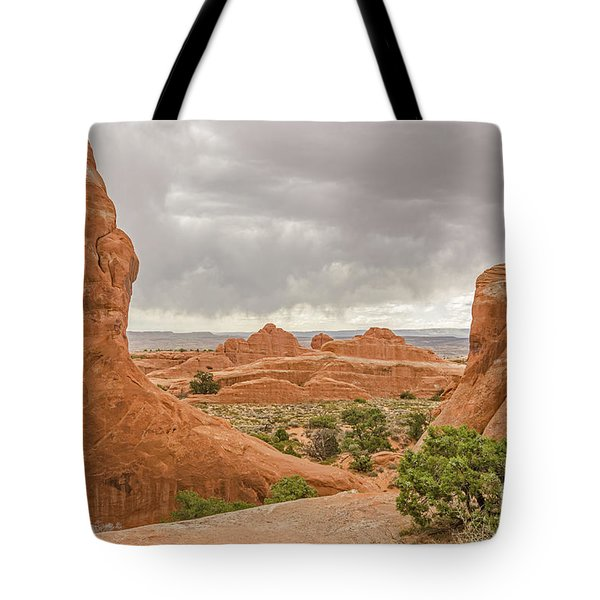 Tote Bag featuring the photograph Rain In The Distance At Arches by Sue Smith