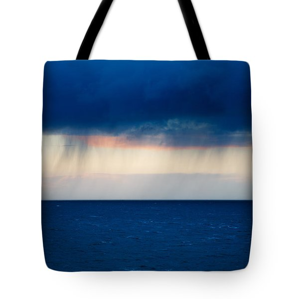 Tote Bag featuring the photograph Rain On The Horizon At Strumble Head by Ian Middleton