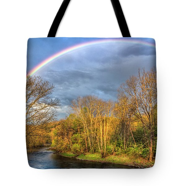 Tote Bag featuring the photograph Rainbow Over The River by Debra and Dave Vanderlaan