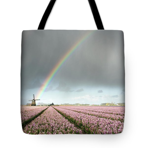 Tote Bag featuring the photograph Rainbow Over Windmill And Flower Fields by IPics Photography