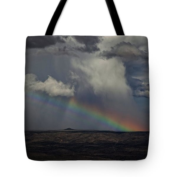 Tote Bag featuring the photograph Rainbow Storm Over The Verde Valley Arizona by Ron Chilston