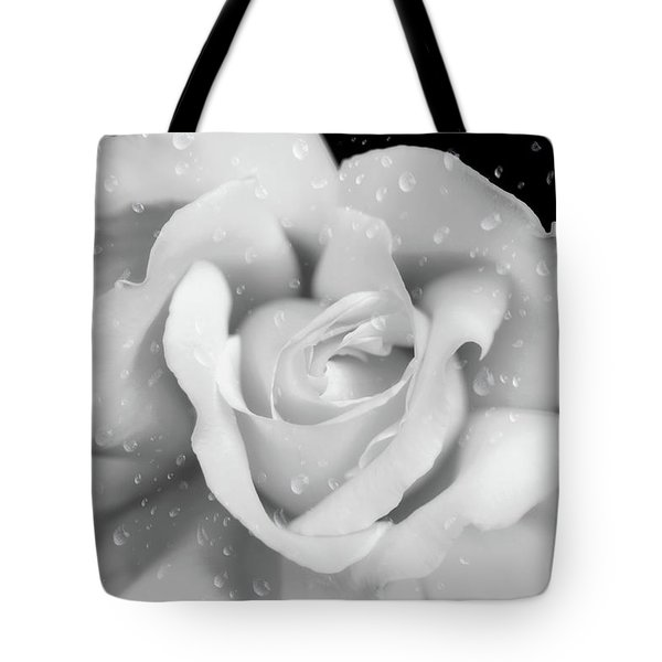 Tote Bag featuring the photograph Raindrops On Rose Black And White by Jennie Marie Schell