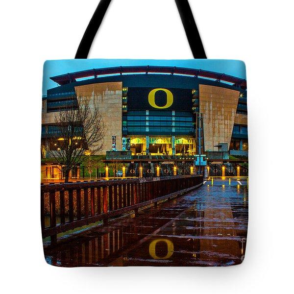 Rainy Autzen Stadium Tote Bag by Michael Cross