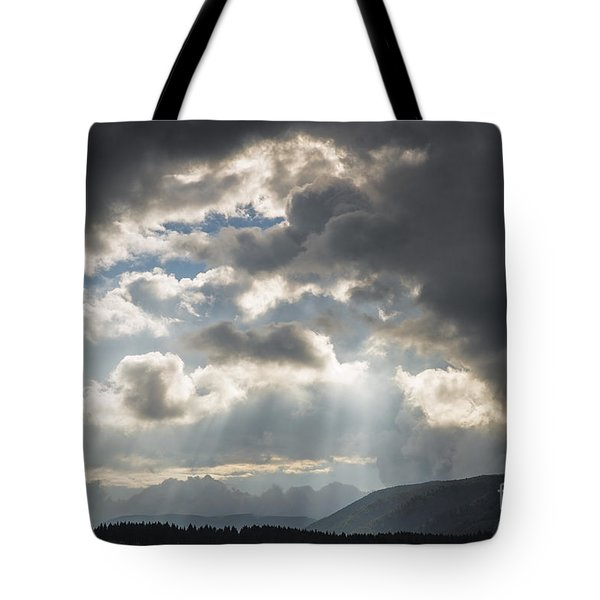 Tote Bag featuring the photograph Rainy Light by Yuri Santin