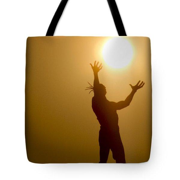 Raising The Sun Tote Bag