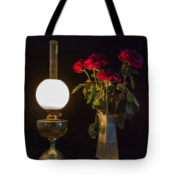 Tote Bag featuring the photograph Reading By Oil Lamp by Brian Roscorla