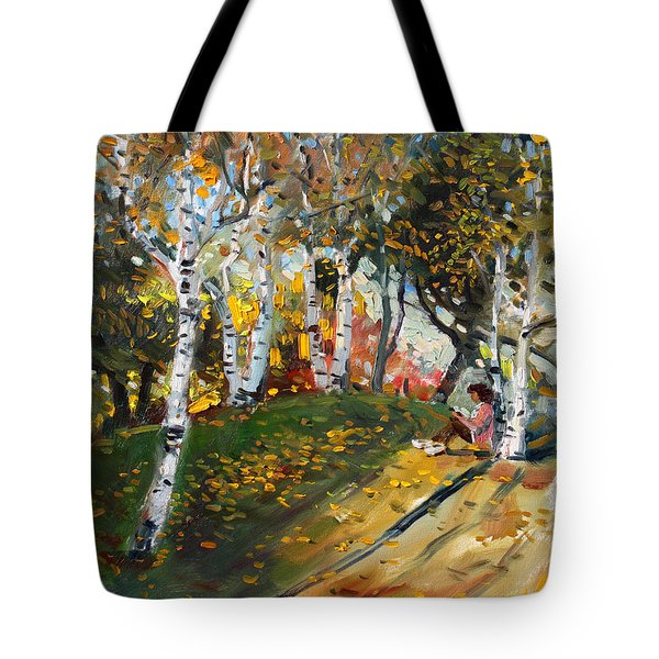 Reading In The Park  Tote Bag by Ylli Haruni