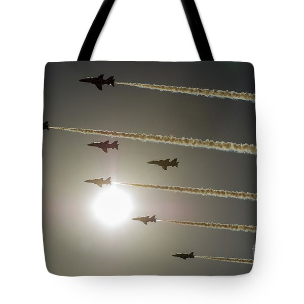 Tote Bag featuring the photograph Red Arrows Backlit Arrival  by Gary Eason