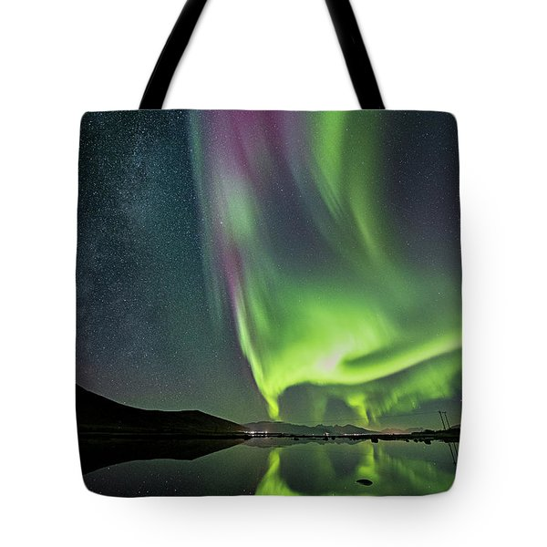Red Auroras And A Faint Milky Way Tote Bag
