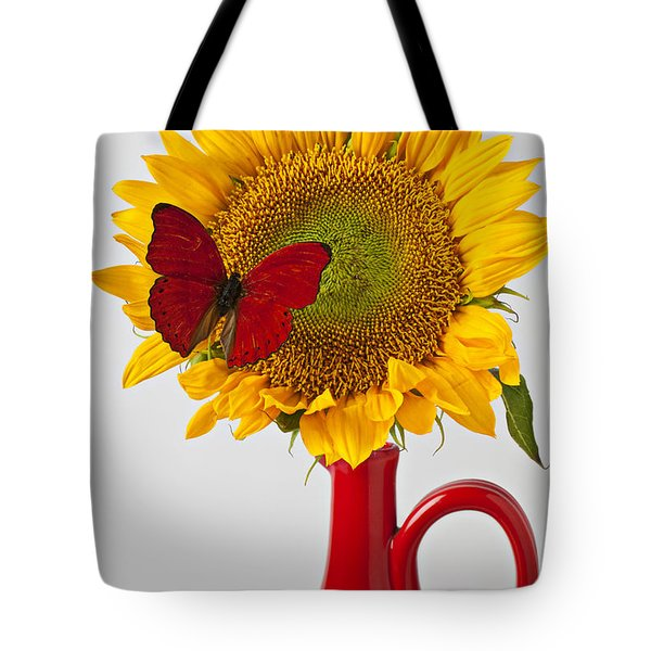 Red Butterfly On Sunflower On Red Pitcher Tote Bag by Garry Gay