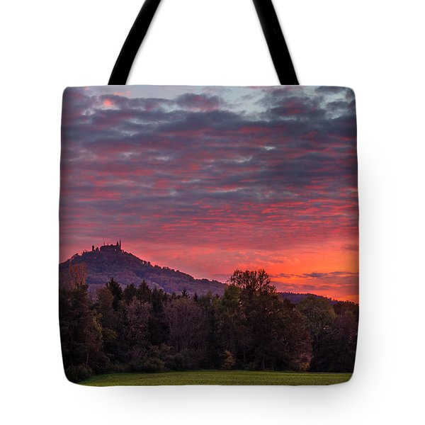 Tote Bag featuring the photograph Red Dawn Over The Hohenzollern Castle by Dmytro Korol