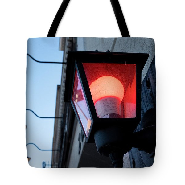 Red Light On The Wall With A Blue Sky And Yellow Bulbs In Holland Michigan Tote Bag