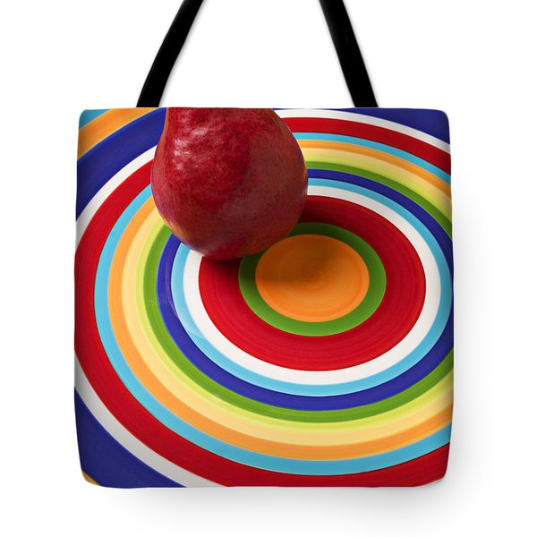 Red Pear On Circle Plate Tote Bag by Garry Gay