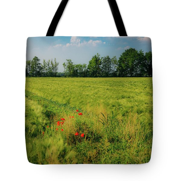Red Poppies On A Green Wheat Field Tote Bag