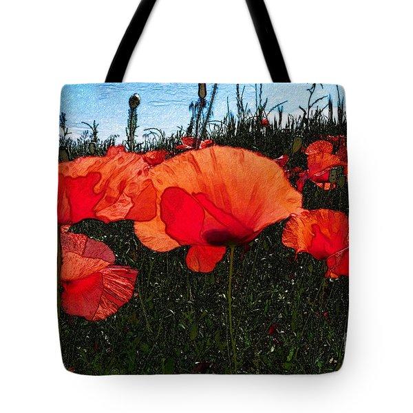 Tote Bag featuring the photograph Red Poppy Flowers In Grassland by Jean Bernard Roussilhe