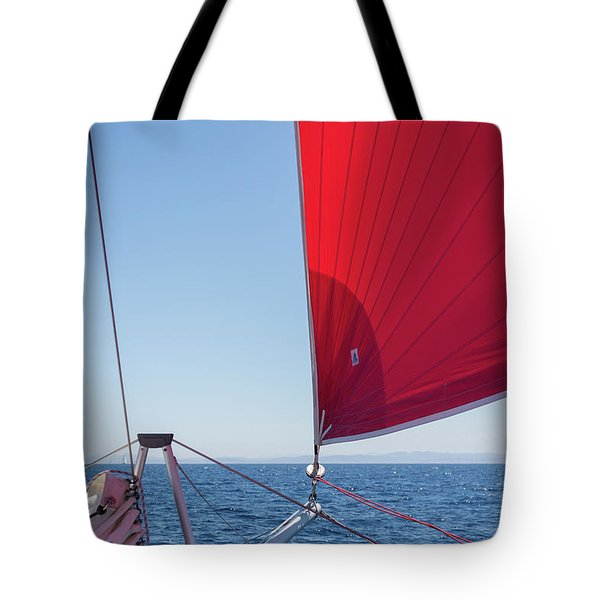 Tote Bag featuring the photograph Red Sail On A Catamaran by Clare Bambers