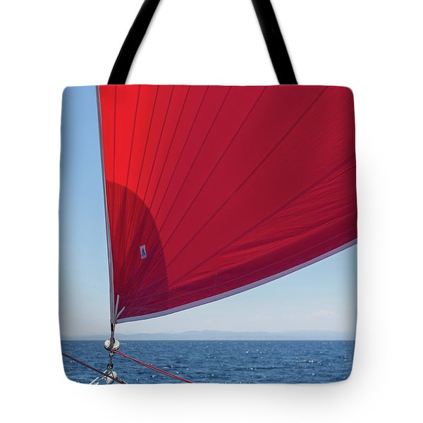Tote Bag featuring the photograph Red Sail On A Catamaran 2 by Clare Bambers