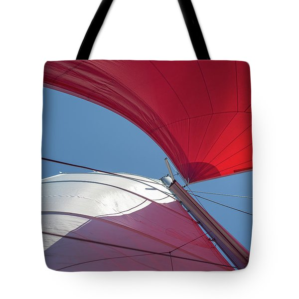 Tote Bag featuring the photograph Red Sail On A Catamaran 3 by Clare Bambers