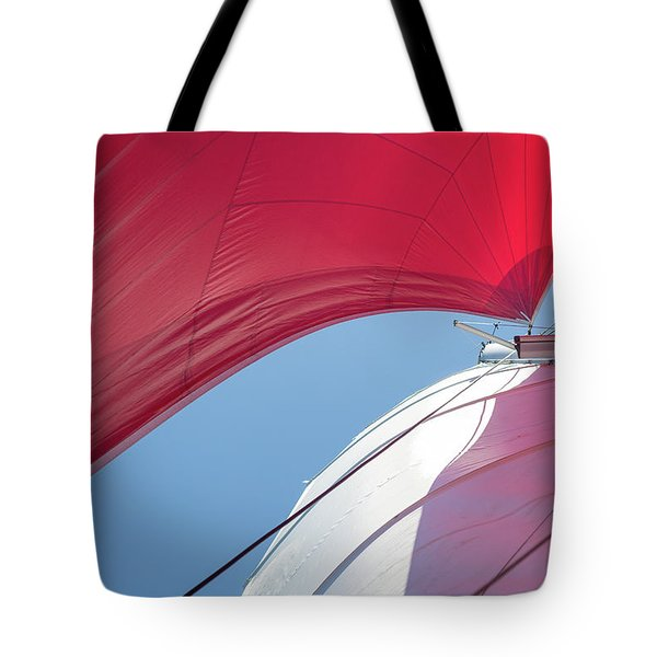 Tote Bag featuring the photograph Red Sail On A Catamaran 4 by Clare Bambers