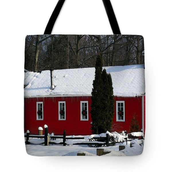 Red Schoolhouse At Christmas Tote Bag by Desiree Paquette