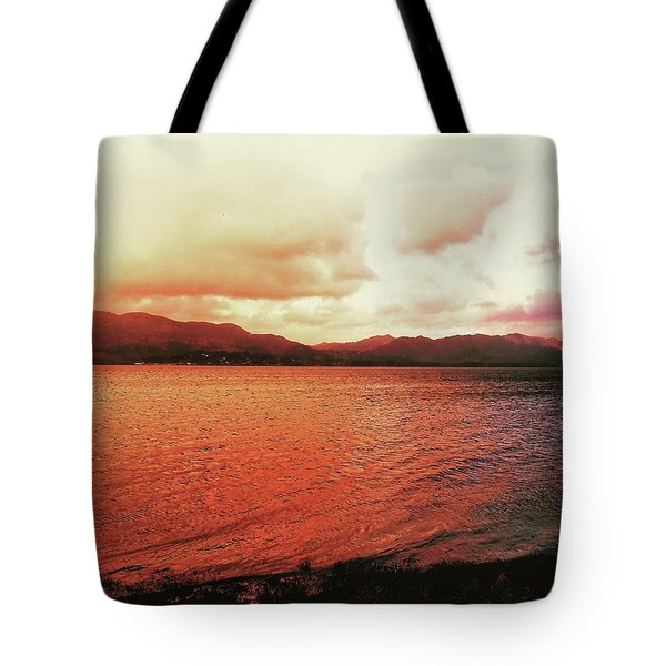Tote Bag featuring the photograph Red Sky After Storms  by Chriss Pagani