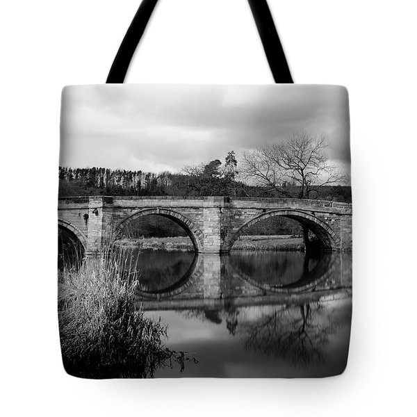 Tote Bag featuring the photograph Reflecting Oval Stone Bridge In Blanc And White by Dennis Dame