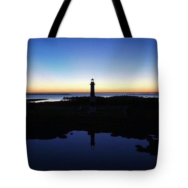 Reflection Of Bodie Light At Sunset Tote Bag