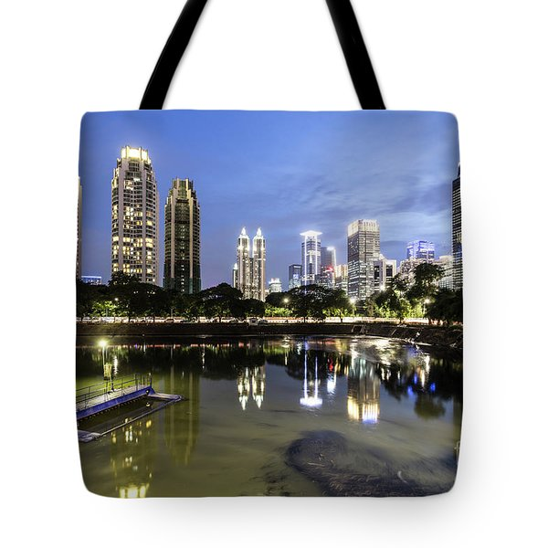 Reflection Of Jakarta Business District Skyline During Blue Hour Tote Bag