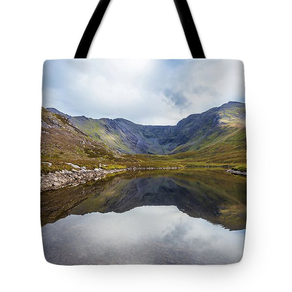 Tote Bag featuring the photograph Reflection Of Macgillycuddy's Reeks And Carrauntoohil In Lough E by Semmick Photo