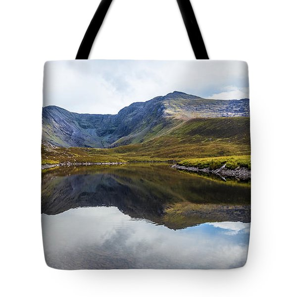 Tote Bag featuring the photograph Reflection Of The Macgillycuddy's Reeks In Lough Eagher by Semmick Photo
