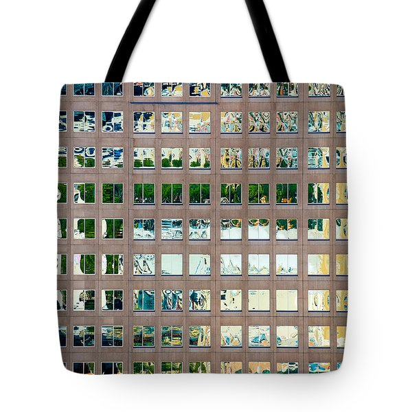 Tote Bag featuring the photograph Reflections In Windows Of Office Building by Bryan Mullennix