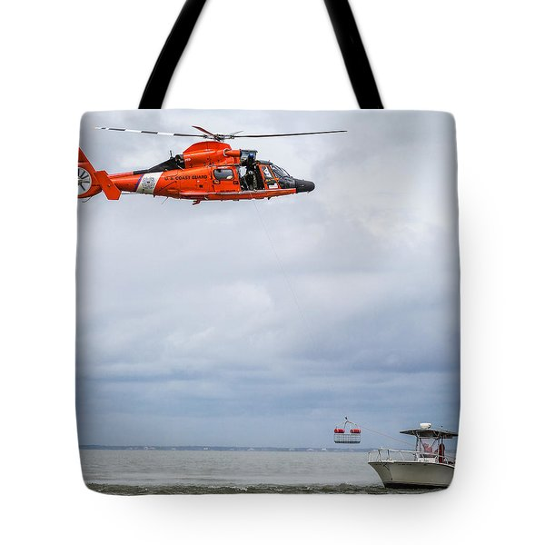 Tote Bag featuring the photograph Rescue Basket Lowered by Gregory Daley  PPSA