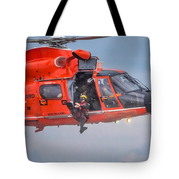 Tote Bag featuring the photograph Rescue Swimmer Jumps From Helicopter by Gregory Daley  PPSA