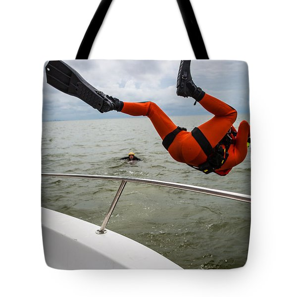 Tote Bag featuring the photograph Rescue Swimmer Overboard by Gregory Daley  PPSA
