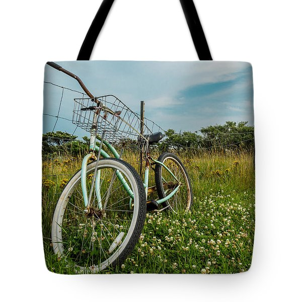 Tote Bag featuring the photograph Resting Bike With Flowers by Jose Oquendo