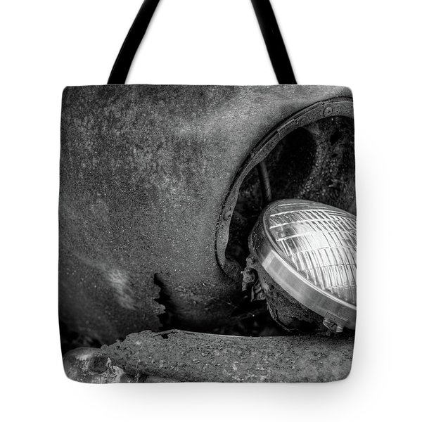 Tote Bag featuring the photograph Resting Headlight Of Rusty Car by Dennis Dame