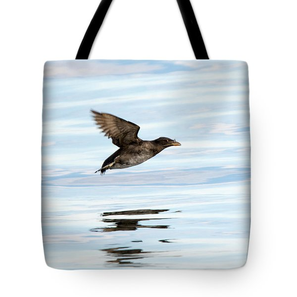 Rhinoceros Auklet Reflection Tote Bag by Mike Dawson
