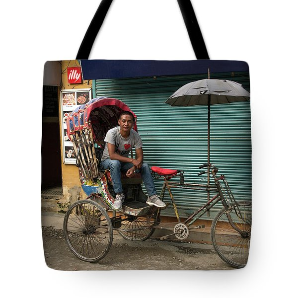 Rickshaw Driver Waiting For His Next Client In Narrow Streets Of Nepal Tote Bag