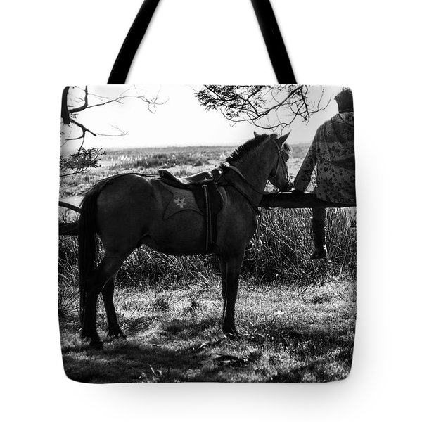 Tote Bag featuring the photograph Rider And Horse Taking Break by Pradeep Raja Prints