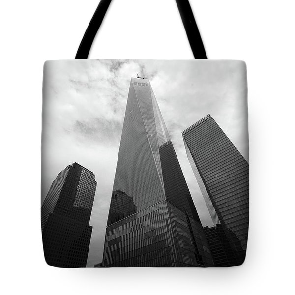 Tote Bag featuring the photograph Risen Out Of The Rubble by John Schneider