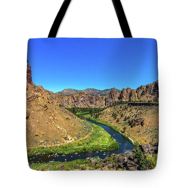 Tote Bag featuring the photograph River Through Mountains by Jonny D