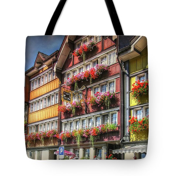 Tote Bag featuring the photograph Row Of Swiss Houses by Hanny Heim
