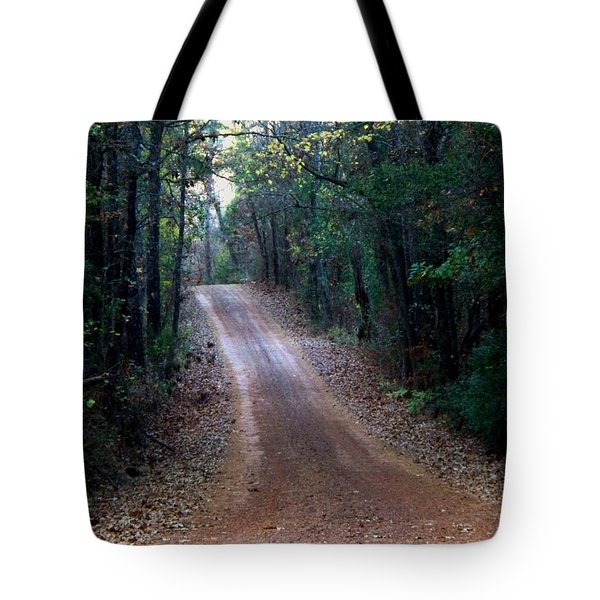 Tote Bag featuring the photograph Road Not Taken by Betty Northcutt