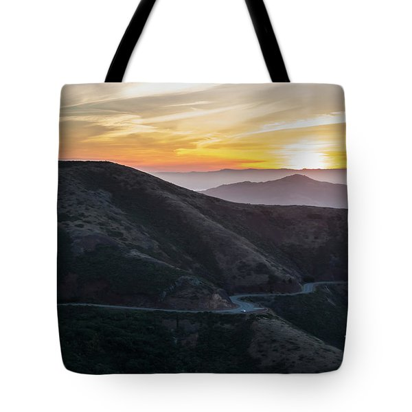 Road On The Edge Of The Mountain With Sunrise In The Background Tote Bag