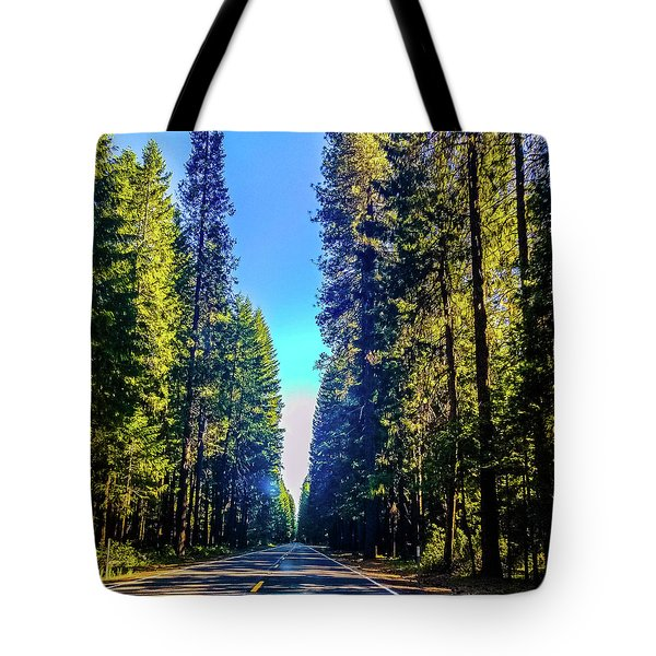 Tote Bag featuring the photograph Road Through The Forest by Jonny D