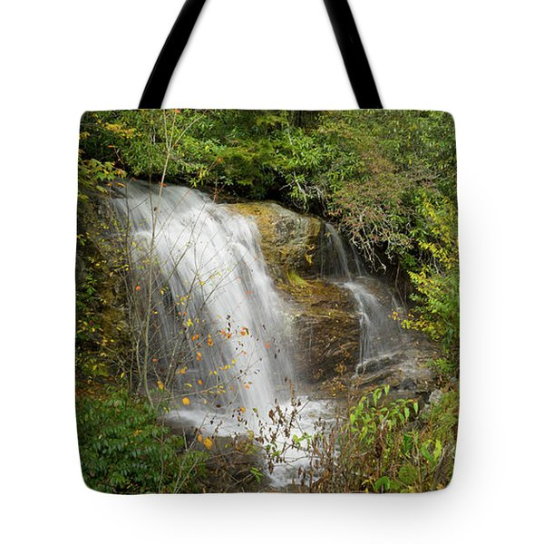 Tote Bag featuring the photograph Roadside Waterfall In North Carolina by Mike McGlothlen