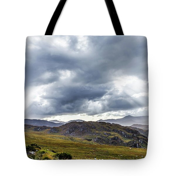 Tote Bag featuring the photograph Rock Formation Landscape With Clouds And Sun Rays In Ireland by Semmick Photo